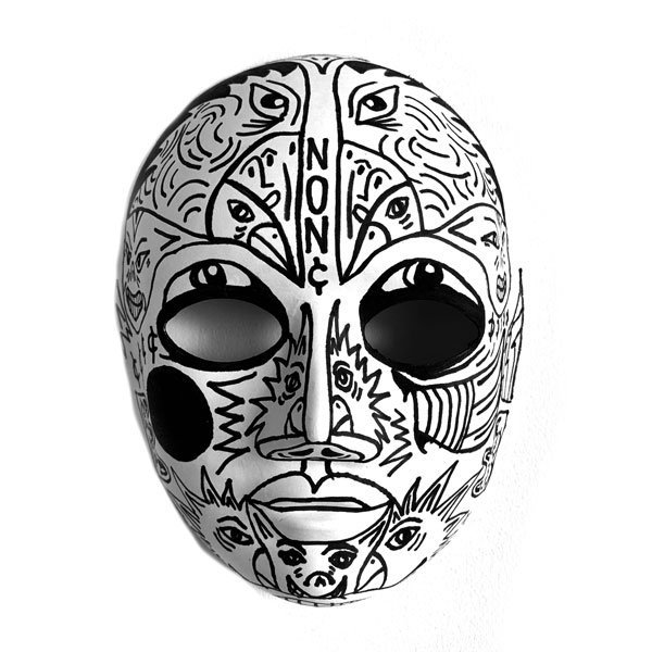 Black line drawings cover a white cardboard face mask with eyes, animals, words, and other designs